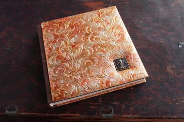 Photobook with a cover of genuine leather. Beautiful cover with