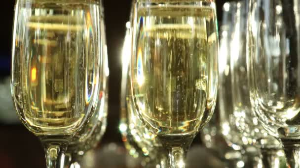 Glasses of sparkling wine in the light close-up. Lots of gas bubbles