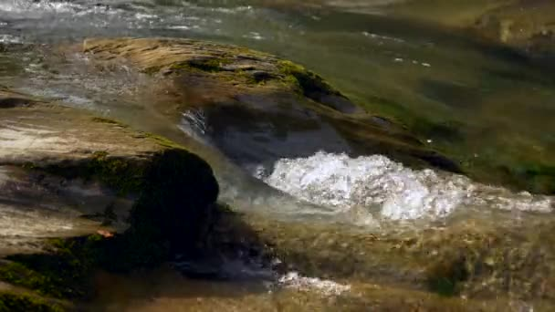 Close-up Shot Clear Water In Rocky River. Mountain River Waterfalls. Slow motion 4k 30p 0.5 speed of 60p