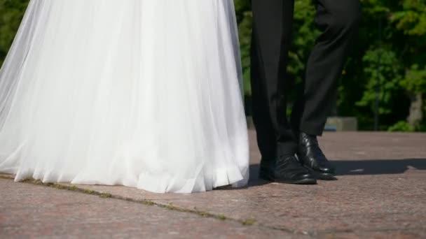 Close-up Bride and Groom Footsteps. Long White Dress on Granite Floor. Urban Scene. 2x Slow motion - 0,5 Speed 60 FPS