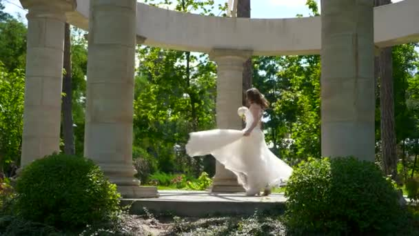 Bride and Groom Meet among Antique Columns. Happy Couple in Summer Park. 2x Slow motion - 0,5 Speed 60 FPS