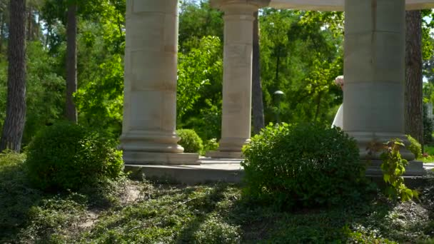 Bride Waiting Alone Dancing among Antique Columns. Summer Park. 2x Slow motion - 0,5 Speed 60 FPS