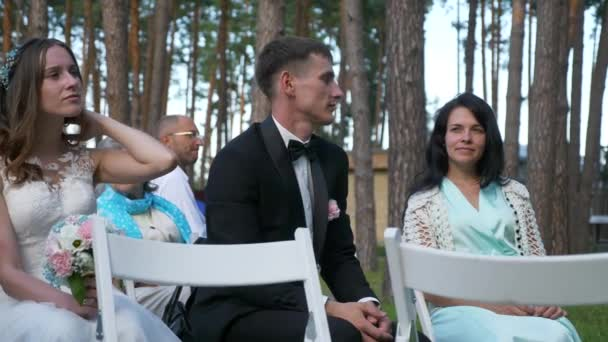 Newlyweds Bride and Groom Spend Time with Guests at Wedding Ceremony on Nature. 2x Slow motion - 0,5 Speed 4K 60 FPS