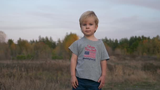 Boy with sign Future President on T-shirt Shows Different Emotions Expressions on his Face