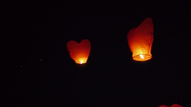 Lots of Chinese lanterns flying in the night sky