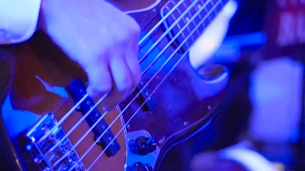 Rock musician plays solo guitar. Closeup of rock guitar player hands