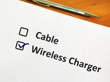 One person is answering question. He is choosing between cable cahrger or wireless charger.