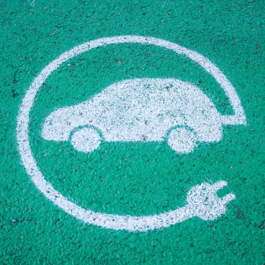 Symbol of a charging slot for electric cars, white over green background