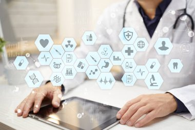 Medical doctor working with modern computer virtual screen interface. Medicine concept. EHR, Electronic Health Records.