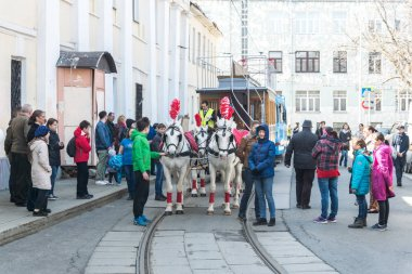 MOSCOW, RUSSIA - april 21: A horsecar with four horses in a harness takes part in a tram parade on Chistoprudny Boulevard in Moscow