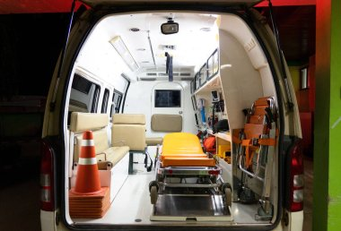 Inside an ambulance with medical equipment . Car for patient refer .