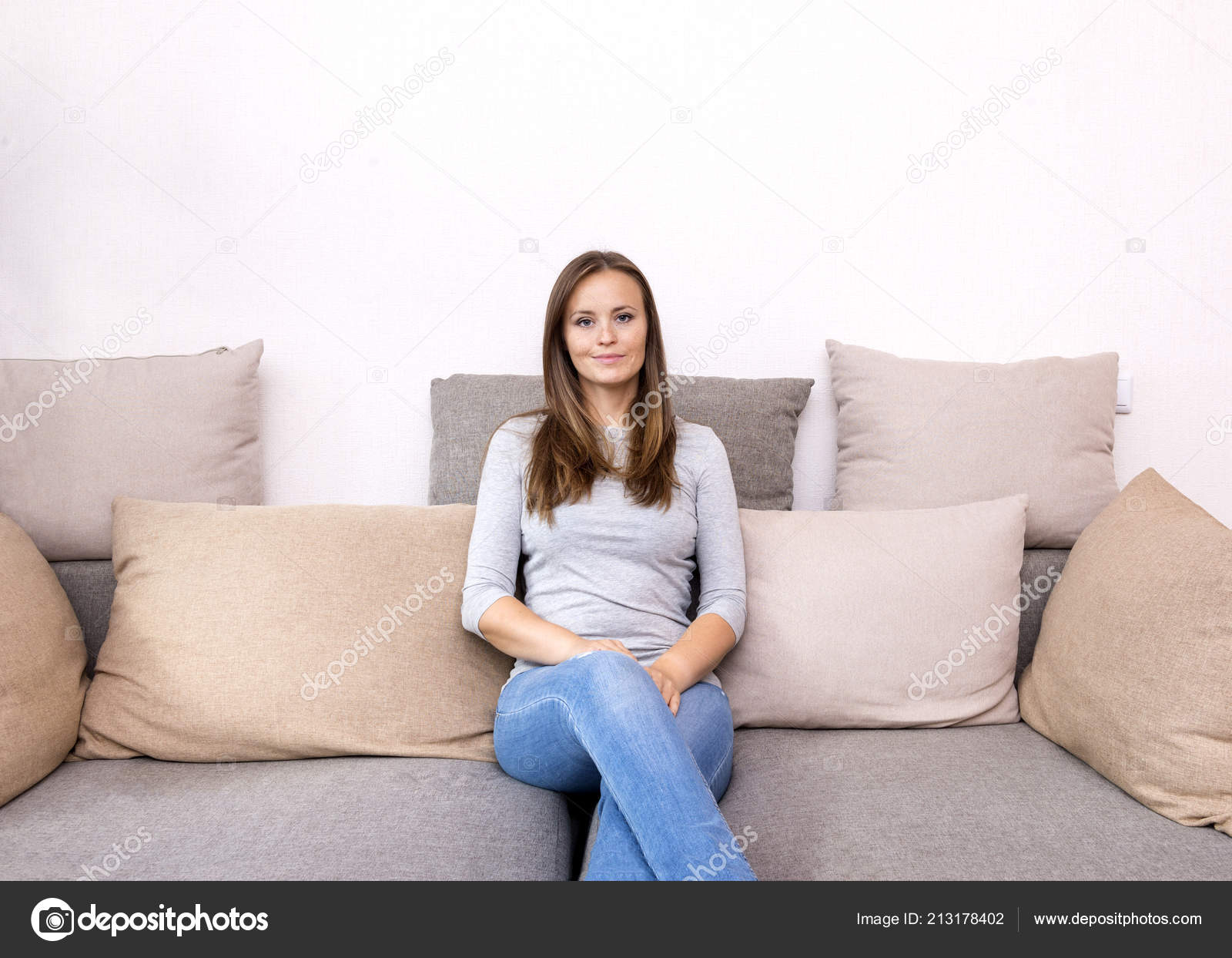 Surprising Images A Woman Sitting On A Couch White Young Woman Squirreltailoven Fun Painted Chair Ideas Images Squirreltailovenorg