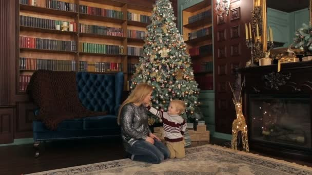 Christmas Gifts For Mom From Son.Mom And Son Open Christmas Gifts Near The Tree