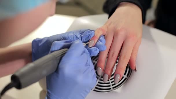 Procedure of professional manicure in beauty salon