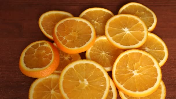 Close-up of juicy sliced orange on a wooden table.