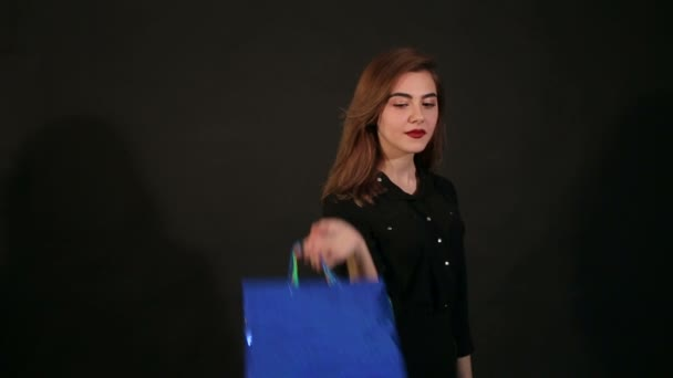 Portrait of a stylish girl with colorful packages