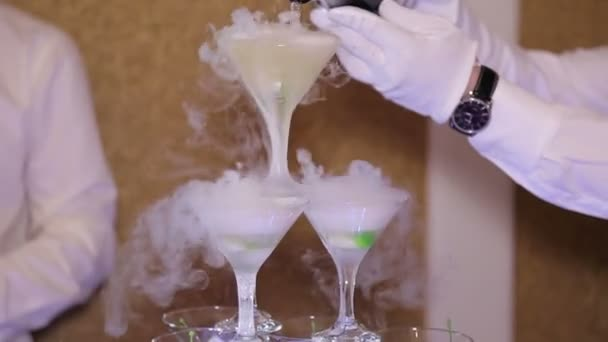 Champagne slide with a steam of dry ice, close-up.