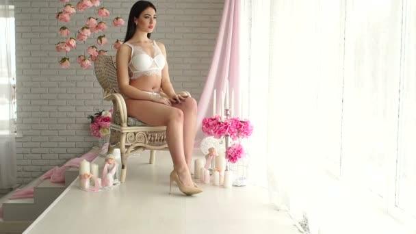 Sexy girl in lingerie posing in the Studio.