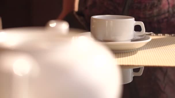 Close-up of a Cup of tea on a table in street cafe