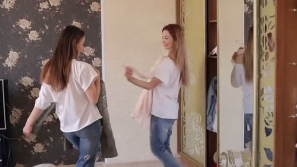 Funny Girls Measure Clothes In Front Of Mirror Stock Video