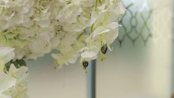 Close-up of white orchids in wedding decoration.