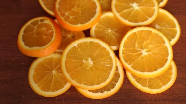 Sliced into circles ripe orange on table, close-up