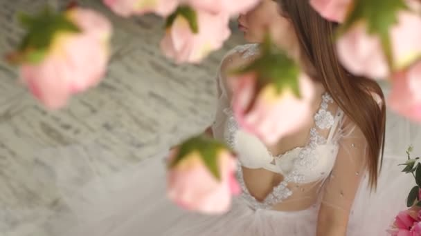 Luxurious elegant girl in lingerie and long lace negligee, close-up.
