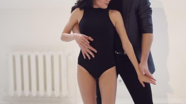 Flexible and sensual dancers dance ballroom dances. Latin dance. Bachata. Salsa.