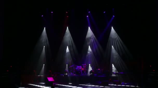 Colored lights on an empty concert stage with smoke. Stage lights and smoke.