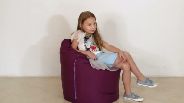 Terrific Cute Little Girl Sitting On Purple Bean Bag Sofa For Living Room Slow Motion Andrewgaddart Wooden Chair Designs For Living Room Andrewgaddartcom