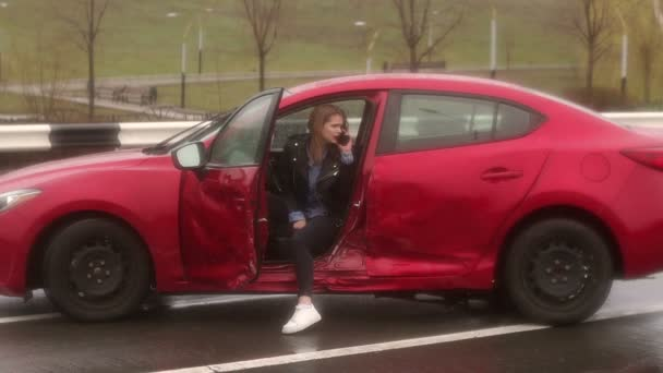 Frightened young girl got into a car accident on a wet road in cold weather.