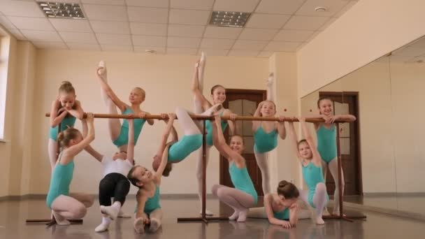 A group of ballerinas in the ballet Studio near the ballet barre after training.