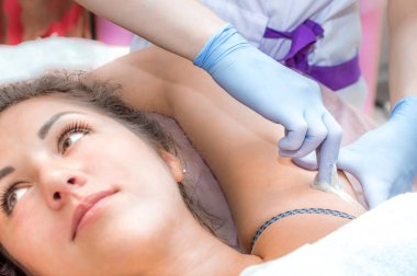 hair removal procedure in the armpit in the beauty salon