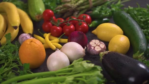 large set of organic, colorful and fresh vegetables on a black wooden table