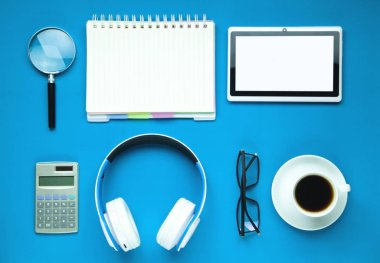 Business objects on blue background. Business concept