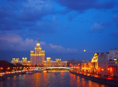 evening view on the river, a residential skyscraper on Kotelnicheskaya Embankment, Moscow River, Bolshoy Ustinsky bridge. Moscow, Russia