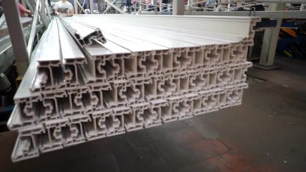 Shelf with profile blanks for the production of plastic windows. Components of PVC windows. Production of plastic windows. Factory for PVC windows and doors production.