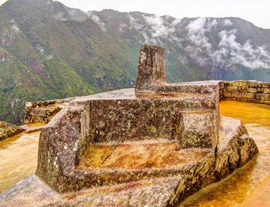 Intihuatana stone as an astronomic clock or calendar by the Incas in Machu Picchu archaeological site with Polygonal masonry at Cuzco, Peru