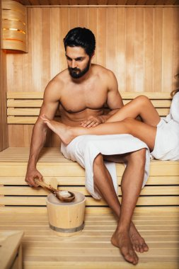 Beautiful couple relaxing in SPA sauna room