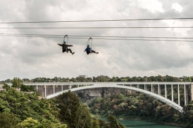 Niagra Falls Canada 06.09.2017 people using the Zipline Attraction extreme ziplining over the waterfalls
