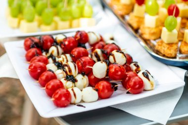 buffet Assortment of canapes. Banquet service. catering food, snacks with mixed fingerfood appetizers