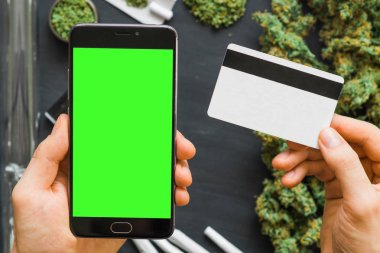 Black smartphone with green screen for chromakey and keying
