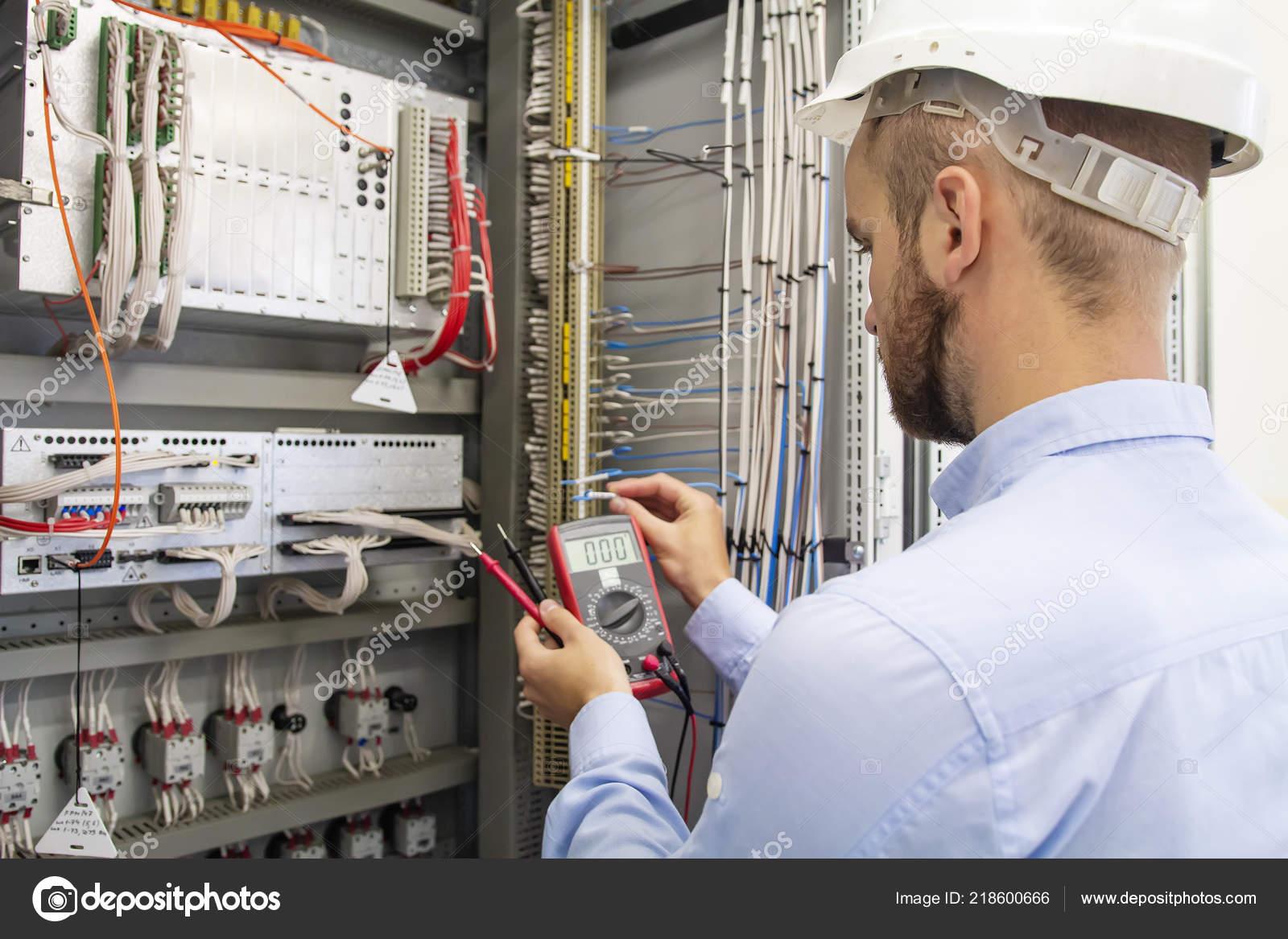 electrician technician in fuse box. maintenance engineer in ...  depositphotos