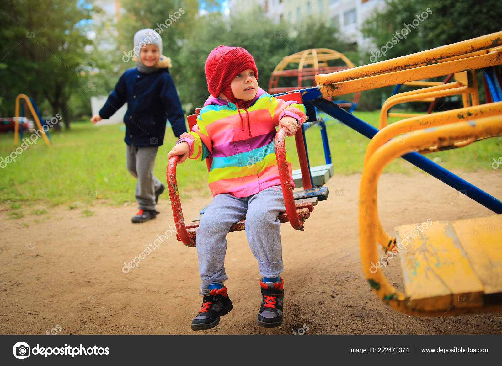 3580f1527 Children ride on the carousel in the playground. Playing children. Little  cute babes ride on a swing — Photo by DzmitRock87@gmail.com  ...