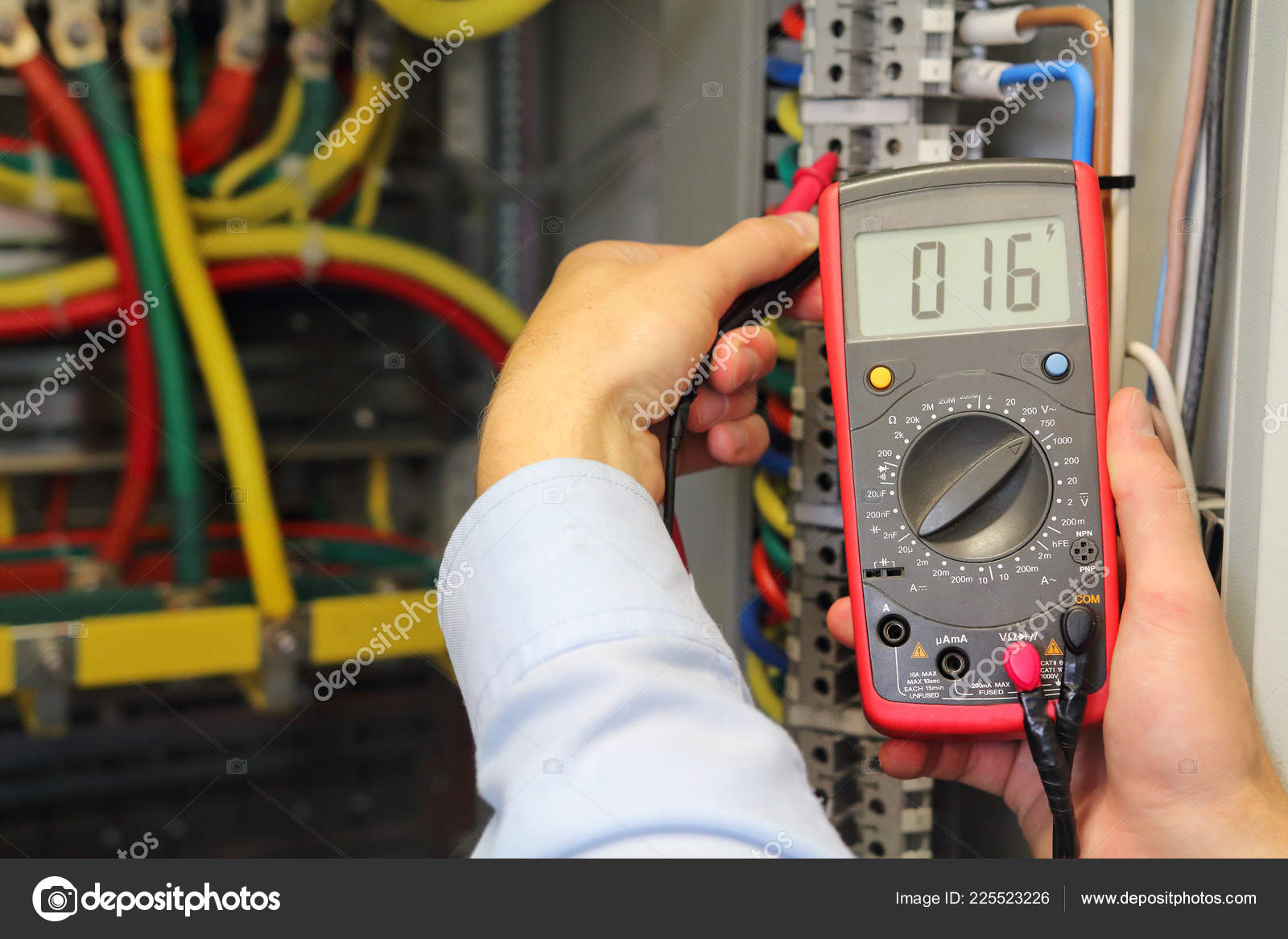 multimeter in hands of electrician. checking voltage in electrical ...  depositphotos