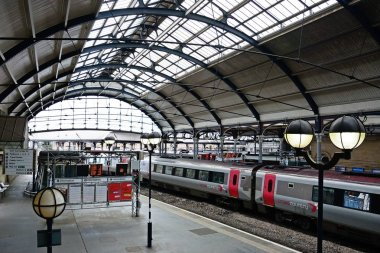 NEWCASTLE, UK  JUNE 11, 2018 - Cross Country train alongside the railway platform in the Newcastle central railway station, Newcastle upon Tyne, Tyne and Wear, England, UK, Western Europe, June 11, 2018.