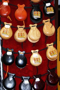 Wooden castanets for sale outside a shop in the town centre, Cordoba, Cordoba Province, Andalucia, Spain, Europe.