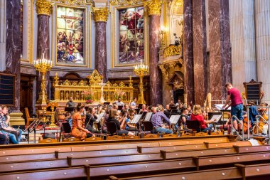 A symphony Orchestra playing inside of the Berlin Cathedral. Berlin, Germany
