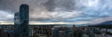 Aerial panoramic view of Downtown City during a stormy summer evening before sunset. Taken in Vancouver, British Columbia, Canada.