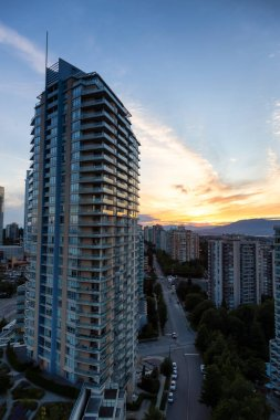 Aerial view of the residential buildings in Metrotown during a vibrant sunset. Taken in Burnaby, Greater Vancouver, BC, Canada.